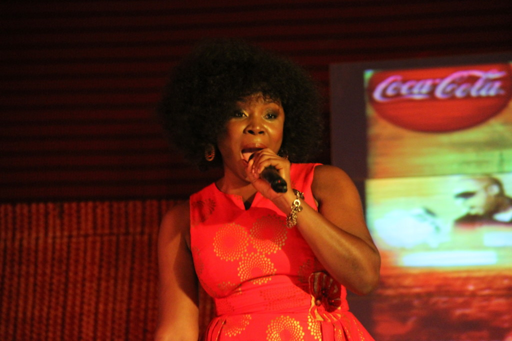 Omawumi performing at the event