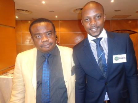 Coson's boss, Tony Okoroje with Akinyemi Ayinoluwa. a writer