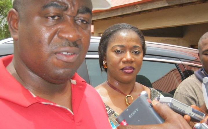 Gabriel Suswan, governor of Benue state, in red t-shirt and flanked by wife at the Makurdi Government House Polling Unit during the 2011 general elections. Photo: Emmanuel Ogala