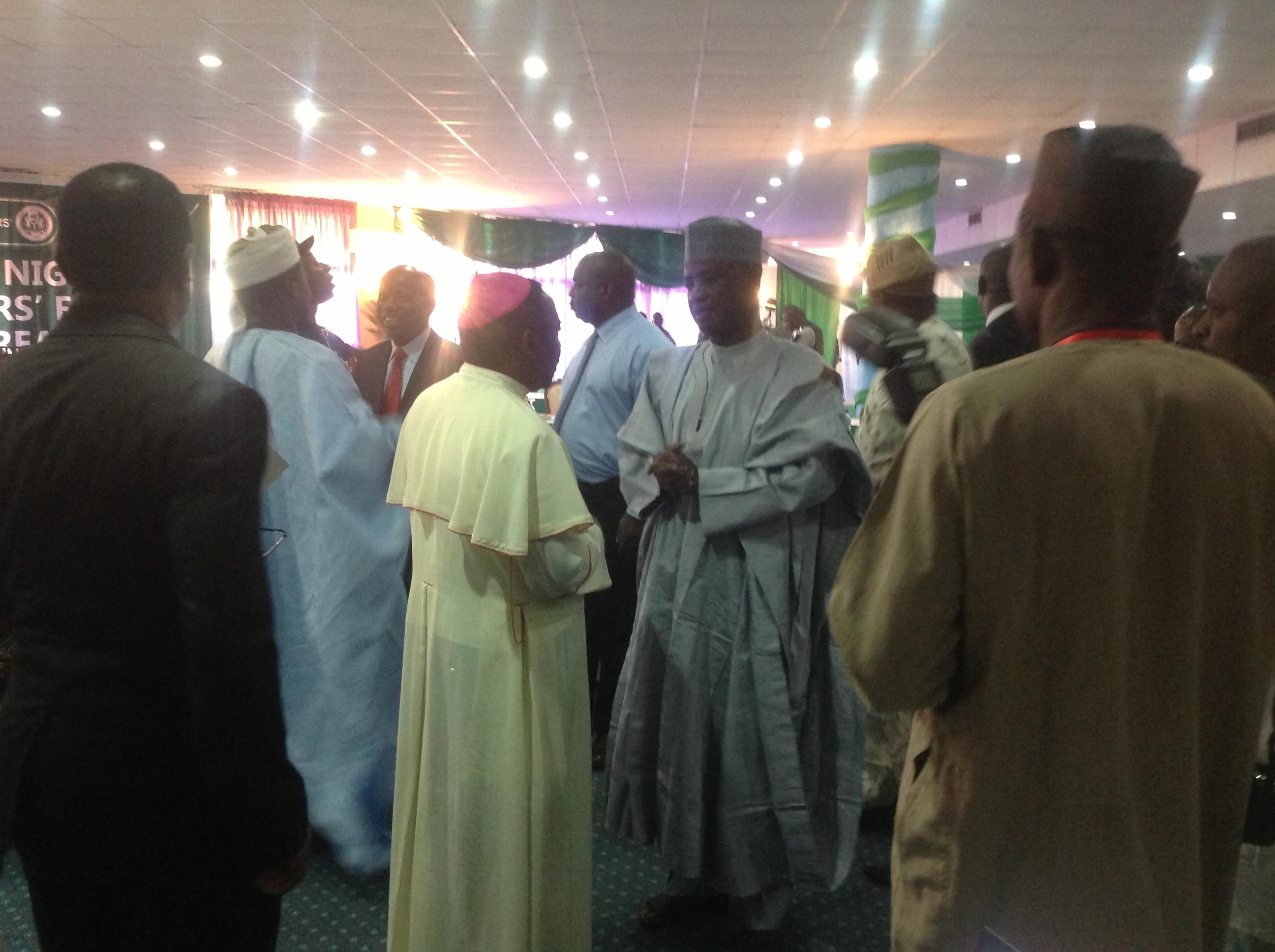 Host governor, Aliyu Wammako, having a chat with Bishop Mathew Kukah