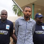 Aminu Oguche and INTERPOL officials on his repatriation back to Nigeria in July 2014