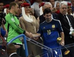 Golden Glove winner Germany's Neuer congratulates Golden Ball winner Argentina's Messi after their 2014 World Cup final in Rio de Janeiro