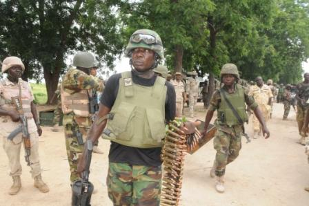 FILE PHOTO: Nigerian troops with captured ammunition from a past operation in Konduga
