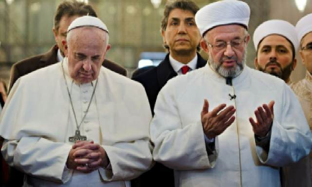 http://media.premiumtimesng.com/wp-content/files/2014/11/Pope-Francis-joins-Islamic-cleric-to-pray-in-Mosque-http___t.co_36BFgTJfON.jpg