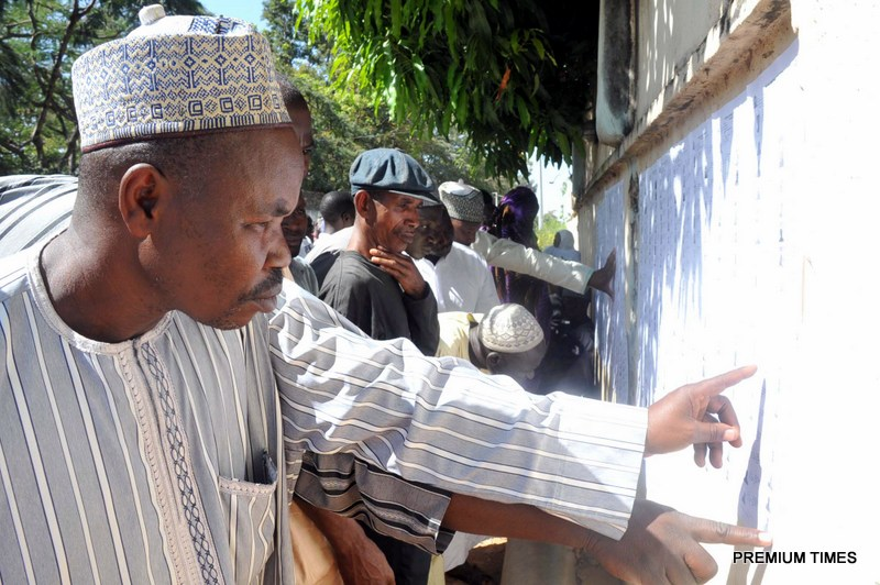 People going through voters list in Kaduna