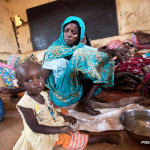FILE PHOTO: A woman and her child in an IPD camp in Gombe. Children, especially those without parents are targeted.