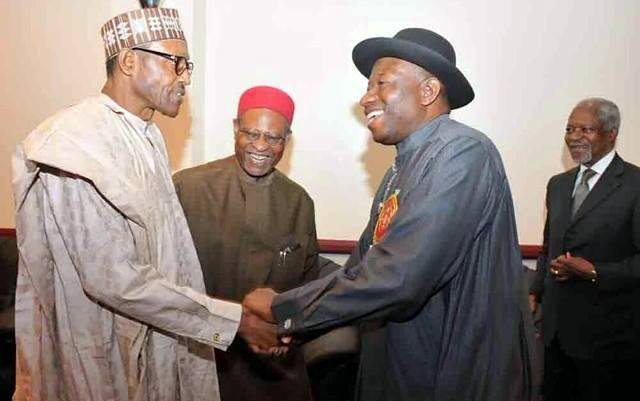President Goodluck Jonathan and General Muhammadu Buhari shaking hands at the 2015 Elections Sensitization Workshop on Non-Violence in Abuja today, organized by the Office of the National Security Adviser and SA to Mr. President on inter-party affairs.