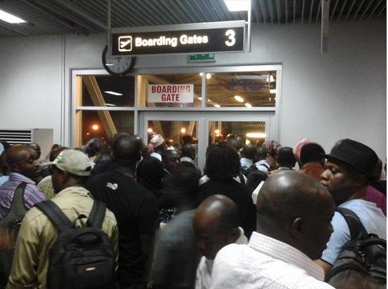 Umrah Banner: Stranded Arik Air Passengers Shut Down Abuja Airport