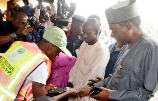 GOV. ISA YUGUaDA OF BAUCHI (R), BEING ACCREDITED DURING THE PRESIDENTIAL AND NATIONAL ASSEMBLY ELECTIONS AT BABA SIDI POLLING UNIT IN BAUCHI ON SATURDAY (28/3/15)