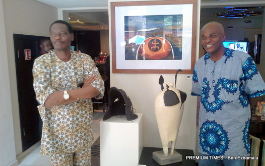Adenaike and Anidi before some of their works