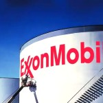 Exxon profit halved by tumbling crude prices