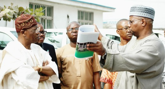 THE GENERAL MANAGER, NATIONAL THEATRE, MR KABIR YUSUF (R), EXPLAINING A POINT TO THE MINISTER OF INFORMATION AND CULTURE, ALHAJI LAI MOHAMMED (L), DURING AN ON-THE-SPOT  INSPECTION OF THE NATIONAL THEATRE BY THE MINISTER, IN LAGOS