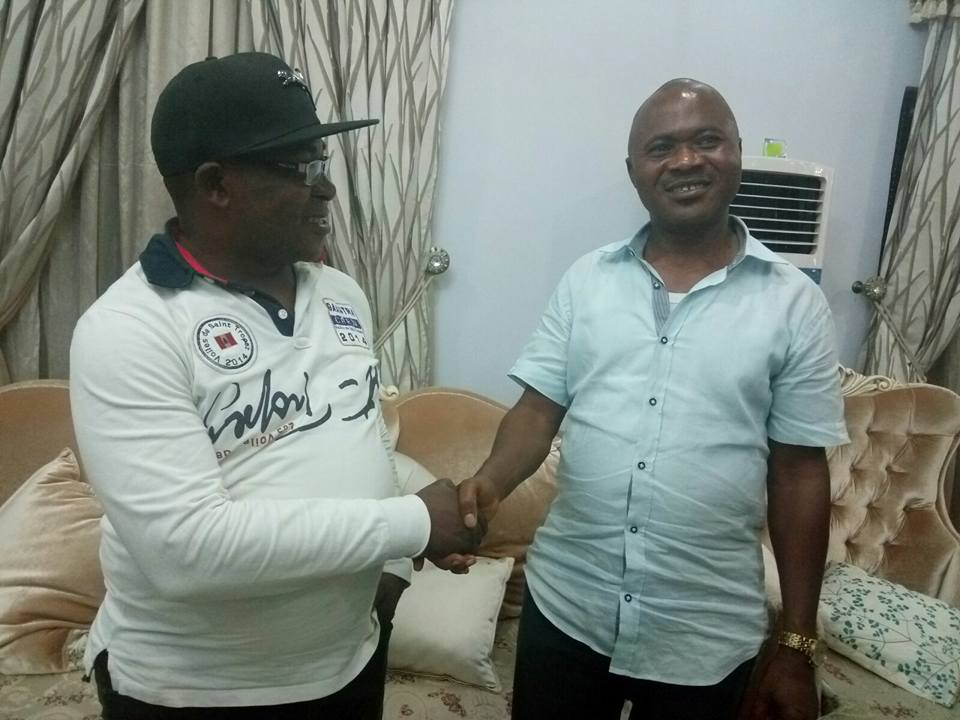 Victor Okon, standing in the left, 'congratulates' his  erstwhile opponent, Effiong Bassey