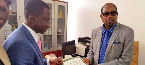 Ogah receiving the Certificate of return from INEC Commissioner Mr  Lawrence Nwuruku