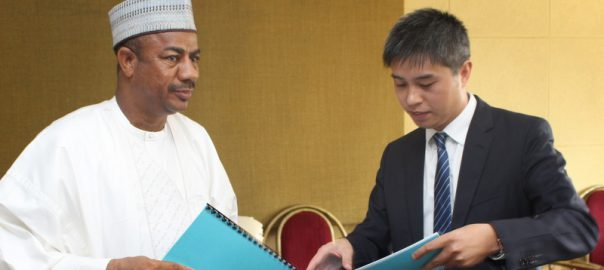 L-R: Secretary to Sokoto State Government (SSG), Professor Bashir Garba, exchanging signed documents with the Assistant Managing Director for Overseas Business of Kunming Engineering Corporation, Qui Haisheng, after the signing of MoU in Sokoto.