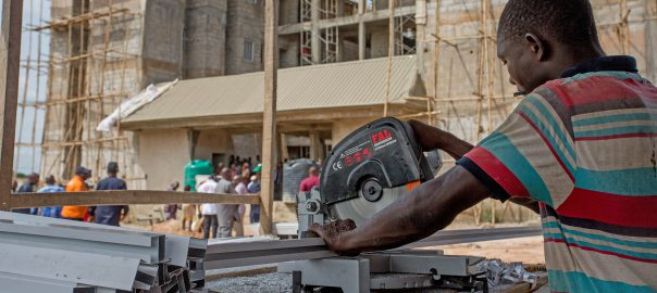 One of the Artisans, Gibson Ogugua working on Aluminium frames for the buildings during the inspection tour of the Hon. Minister of Power, Works & Housing, Mr Babatunde Fashola, SAN to the National Housing Programme site in Ebonyi State on Friday 18th May 2018.