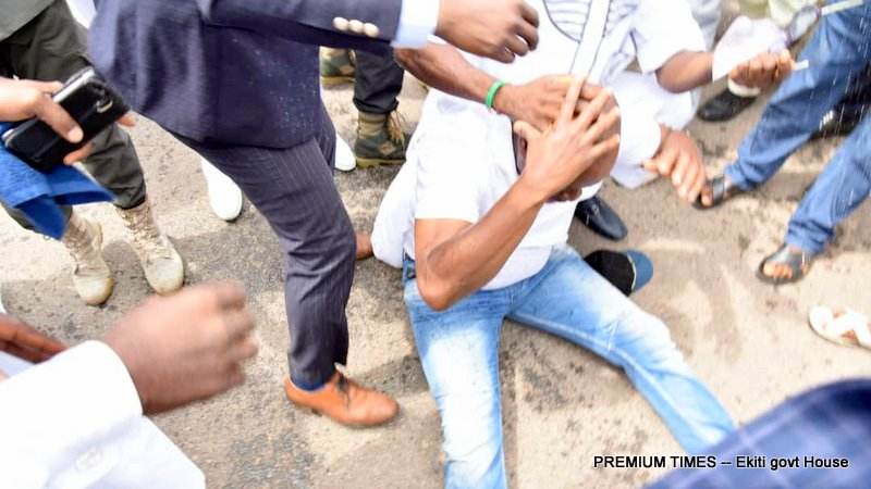 A photo shows a dazed Mr Fayose on the ground as aides tried to stabilise him.