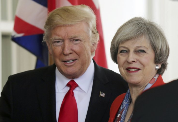The American president's trip coincides with a tumultuous week for Ms May after two senior ministers resigned in protest.