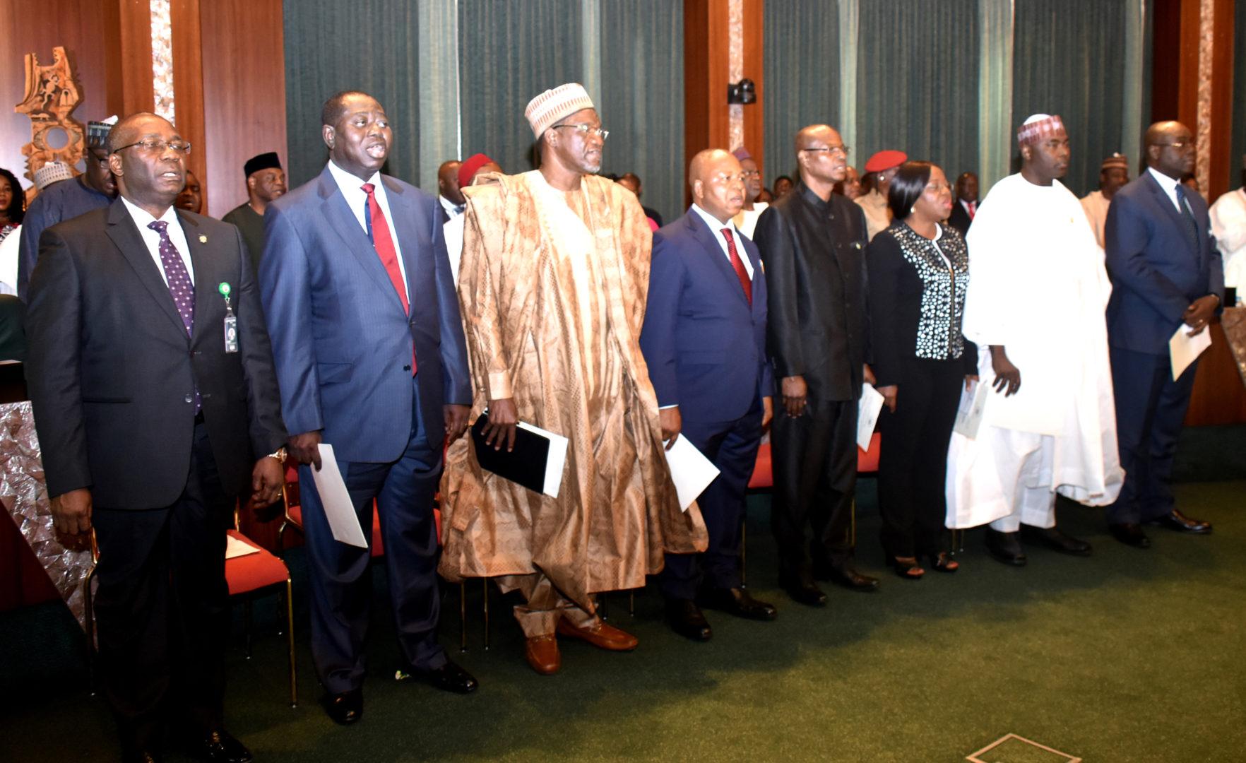Umrah Banner: JUST IN: Buhari Swears In 8 New Permanent Secretaries